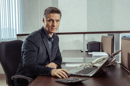 works: European businessman works in the office. Stock Photo
