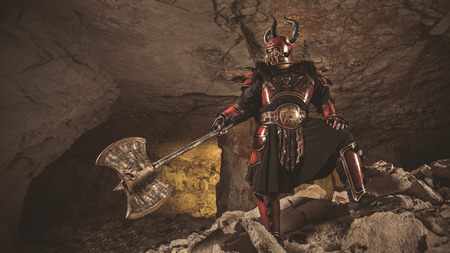 dungeon: Attack of powerful knight in heavy armor on the dungeon background. Stock Photo