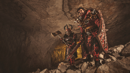 dungeon: Attack of powerful knights in heavy armor on the dungeon background.