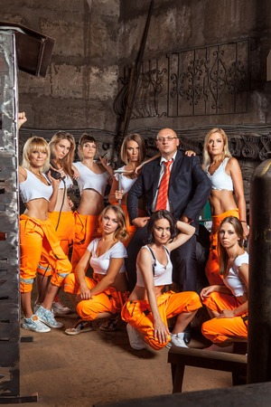 personel: Women workers brigade with the boss in the center. Stock Photo