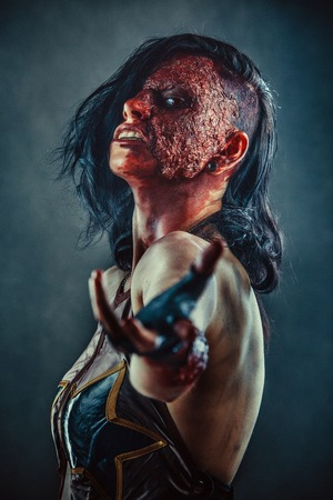 Portrait of Zombie woman with the blood on the face