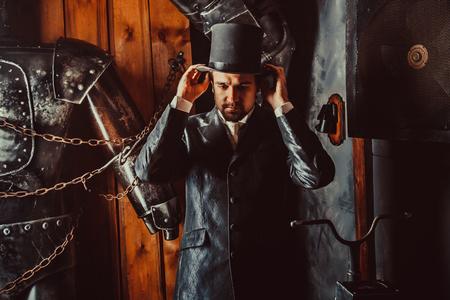 mortician: Side portrait of Victorian gentleman adjusting his top hat. Stock Photo