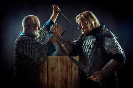 Medieval knights have a hard arm wrestling match