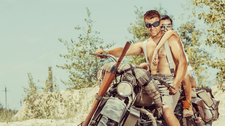 Sexy couple of bikers on the desert motorcycle.