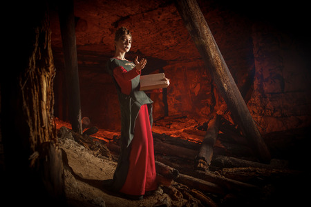 Beautiful young witch with the spellbook.