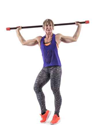 Sporty woman does the exercises with barbell bar on white background. Photo of muscular woman in sportswear on white background. Strength and motivation.