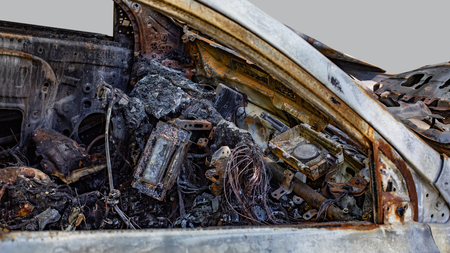 Burnt new car. Isolated on grey background.