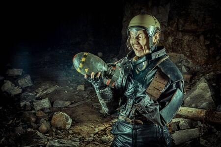 Soldier woman with the bomb on post apocalyptic background.
