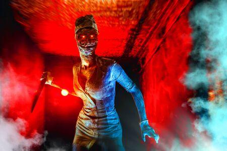 Scary undead zombie in the dark corridor. Halloween theme. 写真素材