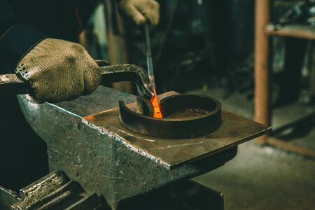 Incandescent element in the smithy on the iron anvil