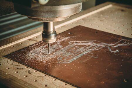PCB Processing on CNC machine. Banco de Imagens - 136661566