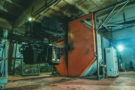 Molding and cast press machine for the manufacture of plastic parts using polymers Stock Photo