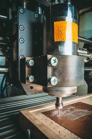 PCB Processing on CNC machine. Toned photo