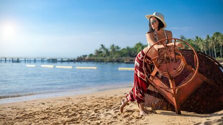 Young woman on a tropical beach. Phu Quoc island, Vietnam. Zdjęcie Seryjne