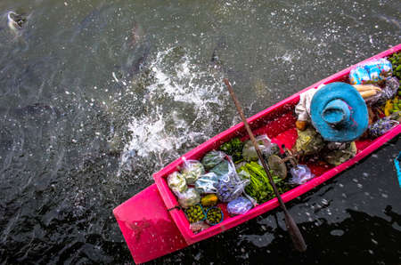 tha: Woman Seen on a Boat at a Morning Floating Market Tha Na Market in Nakhonpathom Thailand Editorial