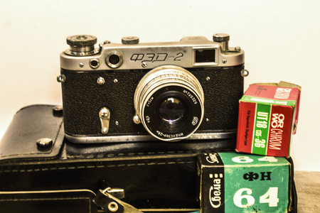 Film retro-camera with boxes from under the film on a white background. 免版税图像