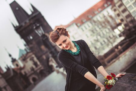 charles: Beautiful lady in Prague on the Charles Bridge Stock Photo