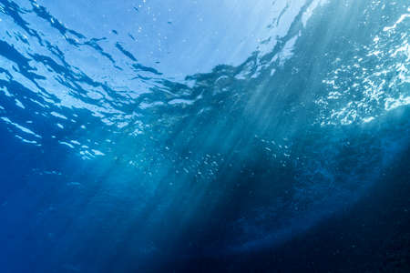 Rays of sunlight shining into sea, underwater view Banco de Imagens