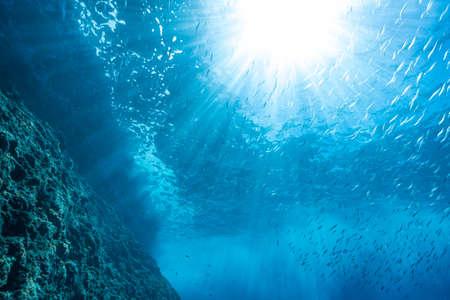 Rays of sunlight into the sea Banco de Imagens