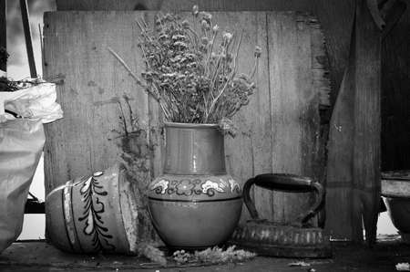 forlorn: Vintage pots and iron with old background.Image with a feeling of abandonment and discarding Stock Photo