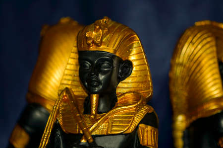 Golden ancient egyptian pharaohs statuette