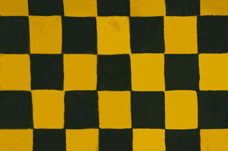 Texture with a chessboard pattern.Abstract background. Background is made of yellow and black color.Grunge textiles.