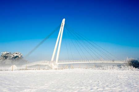 foot bridge: Foot Bridge across a river in snowy weather Stock Photo
