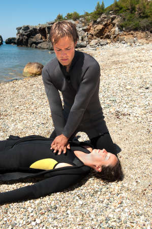 diving save: Diver giving CPR to a diving casualty