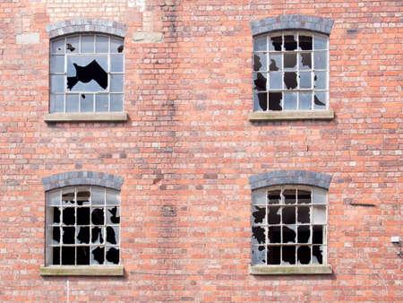 broken glass window: Old building with broken windows