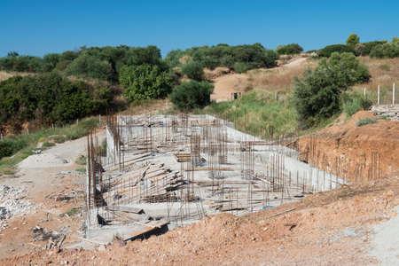 spoiling: Part built reinforced concrete building spoiling the landscape Stock Photo