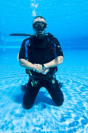 scuba diver: Scuba diver training in a pool Stock Photo