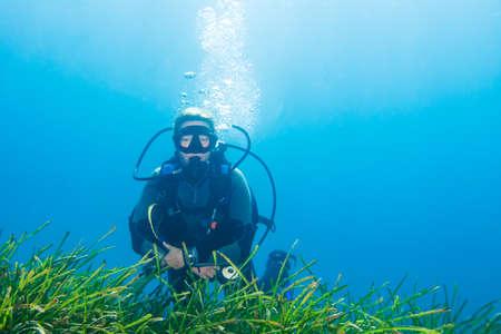 sea grass: Underwater image of a female scuba diver near some sea grass on a dive Stock Photo