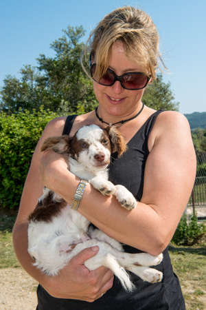 rescued: Rescued Puppy with female helper Stock Photo