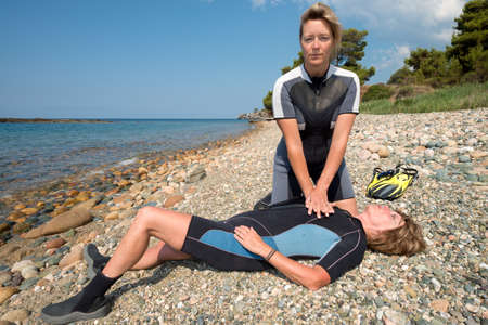 revive: Two Female scuba divers doing rescue training Stock Photo