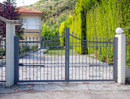 Steel security gates protecting house