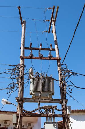 electricity pylon: Dangerous looking electricity pylon Stock Photo