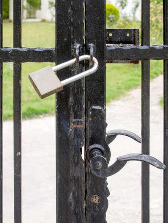 metal gate: Closed padlock on a metal gate