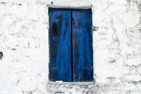 Pair of old blue shutters with faded blue paint photo