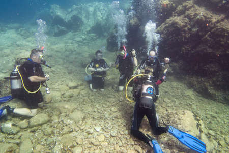 Underwater image of a group of people learning to dive