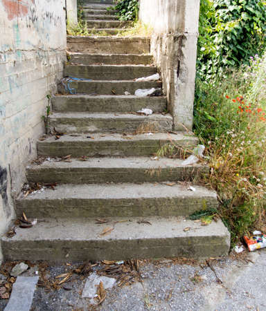 concrete steps: Old worn concrete steps covered with rubbish