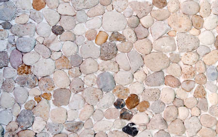 small stones: Wall made of small stones Stock Photo