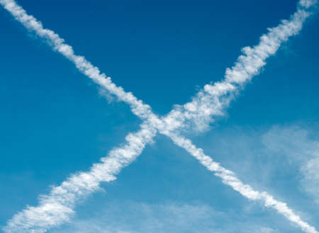vapour: Vapour trails from aircraft forming an cross