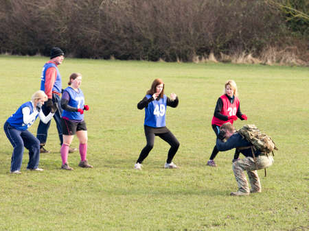 WORCESTER,UK-MARCH 01 2014:Boot Camp participants take part in a military type training session.