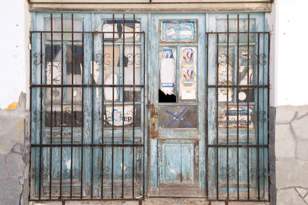 emptied: KASSANDRINO,GREECE-JULY 18 2014:A closed down shop in a small Greek village.Many stores have closed due to the economic state of the Euro zone Editorial