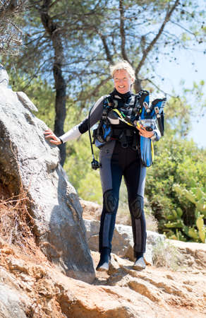 padi: PALIOURI,GREECE-JULY 09 2014 :A female scuba diver makes her way down to a dive site.The number of female scuba divers is growing as more take up the sport.