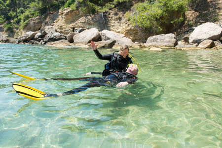 diving save: Two scuba divers having fun on a rescue course Stock Photo