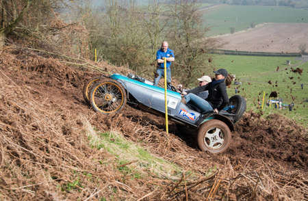 skidding: Worcester , UK - March 13 2016 : Competitors take part in a hill climb to see who can drive their car furthest up a muddy hillside. Editorial