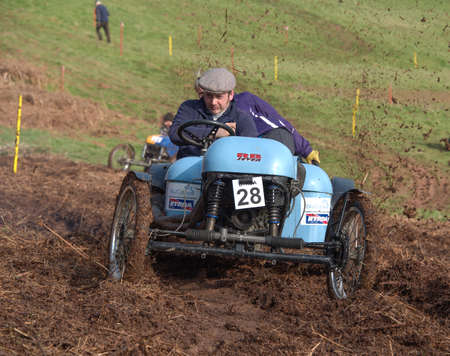 skidding: Worcester , UK - March 13 2016 : Competitors take part in a hill climb to see who can drive their car furthest up a muddy hillside. This was a free to enter event with no photography restrictions. Editorial