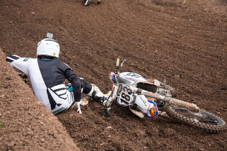 world sport event: Worcester,UK-April 24 2016 :A competitor crashes while taking part in a Motocross race.Motocross is an extreme sport with venues in many countries around the world. This was a free event with no photography restrictions.