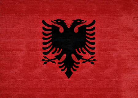 double headed eagle: Illustration of the flag of Albania with a grunge texture. Stock Photo